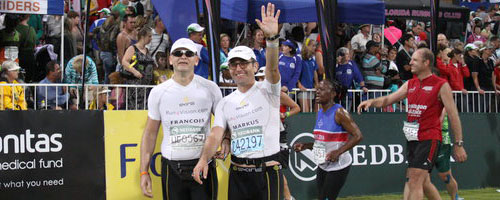 With my blind friend Francois Jacobs at the finish of the 2010 Comrades at Sahara Stadium in Durban.